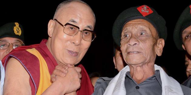 Dalai Lama with Naren Chandra Das, a retired havaldar of 5 Assam Rifles during Namami Brahmaputra festival in Guwahati on Sunday.