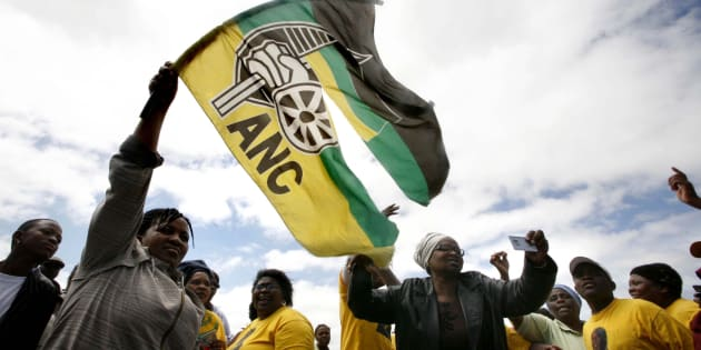 Disgruntled members of the ruling African National Congress tear up an ANC flag as they gather in Cape Town to resign from the party in 2008.  REUTERS/Stringer