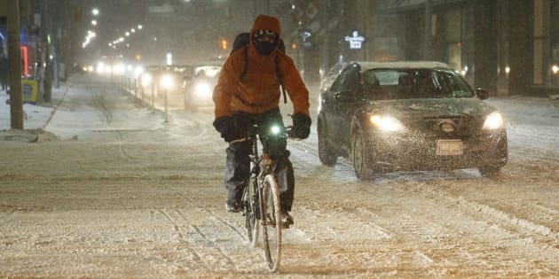 A cyclist commutes during a winter snowstorm in Toronto on Dec. 15, 2016.