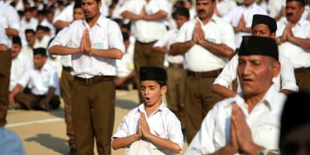 Volunteers of Hindu nationalist Rashtriya Swayamsevak Sangh (RSS), or the National Volunteers Force, perform yoga during 2-day visit of RSS Chief Mohan Bhagwat at Parade Ground in Jammu.