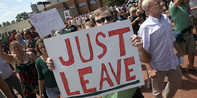 Counter protesters shout outside the Charlottesville City Hall on Aug. 13, 2017 in Charlottesville, Virginia.