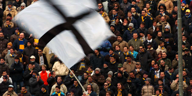 Parma fans wave a giant flag during the game