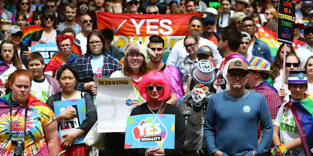 Protesters look on during the yes March for Marriage Equality on October 21, 2017 in Sydney, Australia.
