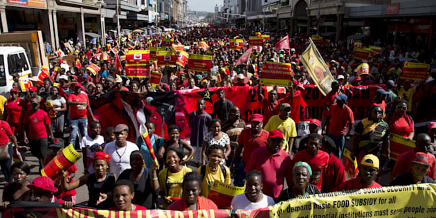 Supporters of the Congress of South African Trade Unions (COSATU) and the South African Communist Party (SACP) lead a march calling for the abolition of labour brokers and the implementation of a national health insurance scheme through Durban, South Africa, April 23, 2016.