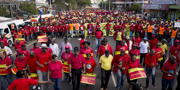 Leaders of the Congress of South African Trade Unions (COSATU) and the South African Communist Party (SACP) lead a march calling for the abolition of labour brokers and the implementation of a national health insurance scheme through Durban, South Africa, April 23, 2016. REUTERS/Rogan Ward