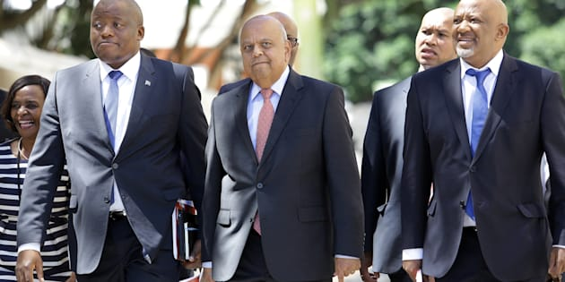 The law doesn't concern itself with trivialities ... Minister of Finance Pravin Gordhan (centre) with his deputy Mcebisi Jonas (left) and National Treasury director-general Lungisa Fuzile (right).