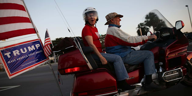 KENDALL, FL - MARCH 09: Supporters of Repubican presidential candidate Donald Trump drive their motorcycle near where Democratic presidential candidate Senator Bernie Sanders (D-VT) and  Democratic presidential candidate Hillary Clinton will face off in a debate at the Univision News and Washington Post Democratic Presidential Primary Debate on the Miami Dade College's Kendall Campus on March 9, 2016 in Kendall, Florida. Voters in Florida will go to the polls March 15th for the state's primary.  (Photo by Joe Raedle/Getty Images)