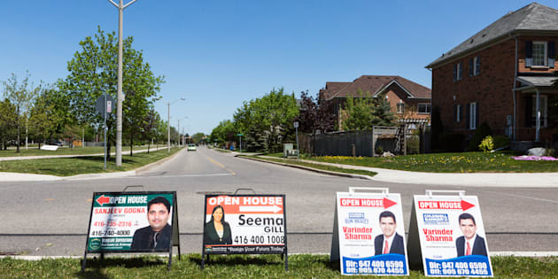 Open house signs are displayed on the side of a road in the Greater Toronto suburb of Brampton, Ontario, Saturday, May 20, 2017. The sharp reversal in Toronto's home prices has thrown Canada's biggest property market into chaos.