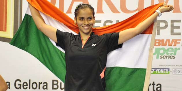 File photo - India's Saina Nehwal waves the Indian flag during the women's singles final medal ceremony at the Indonesian Open 2009 badminton competition in Jakarta on June 21, 2009 against China's Lin Wang.