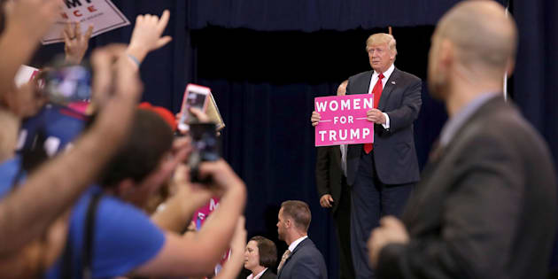 PHOENIX, AZ - OCTOBER 29:  Republican presidential nominee Donald Trump holds a 'Women for Trump' sign during a campaign rally at the Phoenix Convention Center, his seventh visit to the state during this election season, October 29, 2016 in Phoenix, Arizona. The Federal Bureau of Investigation announced Friday it discovered emails pertinent to the closed investigation of Democratic presidential nominee Hillary Clinton's private email server and are looking to see if they improperly contained classified information. Trump said 'I think it's the biggest story since Watergate.'  (Photo by Chip Somodevilla/Getty Images)