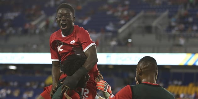 Alphonso Davies celebrates with teammates after scoring during a match between French Guiana and Canada as part of the Gold Cup 2017 on July 7 at Red Bull Arena in New Jersey.