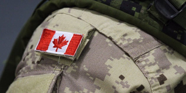 A Canadian flag patch is shown on a soldier's shoulder in Trenton, Ont. on, Oct. 16, 2014.