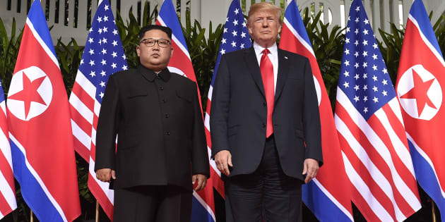 Donald Trump (R) poses with Kim Jong Un (L) at the start of their US-North Korea summit in Singapore on June 12 2018.