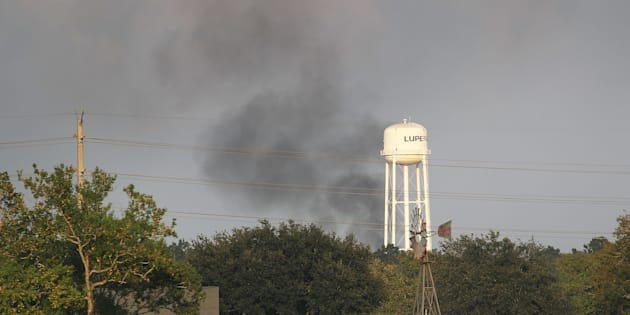 Smoke is seen rising from the Arkema chemical manufacturing and storage facility that burst into flames after Hurricane Harvey's floodwaters knocked out the equipment used to cool the plant's volatile chemicals on Sept. 1, 2017 in Crosby, Texas.