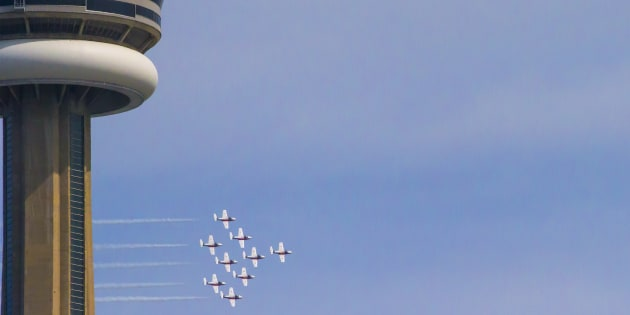 The CF Snowbirds fly past the CN Tower during the on 68th annual Canadian International Air Show during Canada's 150th anniversary year on Sept. 1, 2017 in Toronto, Ont.