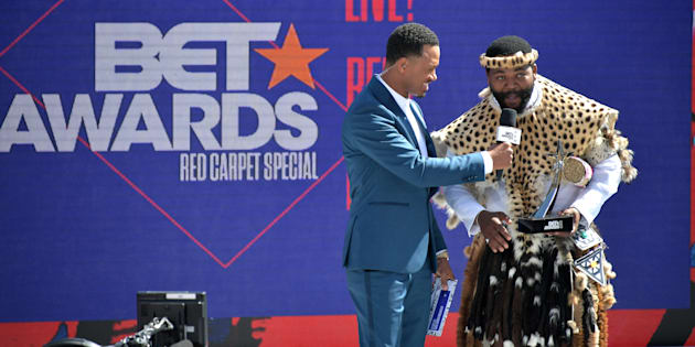 Host Terrence J (L) presents the International Viewers' Choice award for Best New Act to Sjava onstage at Live! Red! Ready! Pre-Show, sponsored by Nissan, at the 2018 BET Awards at the Microsoft Theatre on June 24 in Los Angeles, California.