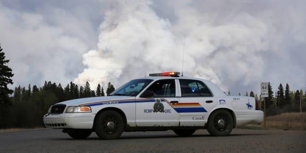 A Royal Canadian Mounted Police car sits at a roadblock near Fort McMurray, Alta. May 5, 2016.