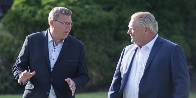 Saskatchewan Premier Scott Moe and Ontario Premier Doug Ford walk to a reception as the Canadian premiers meet in St. Andrews, N.B., on July 18, 2018.
