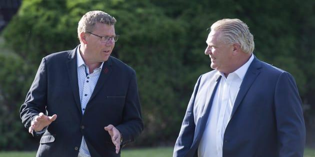 Saskatchewan Premier Scott Moe and Ontario Premier Doug Ford walk to a reception as the Canadian premiers meet in St. Andrews, N.B., on July 18, 2018.