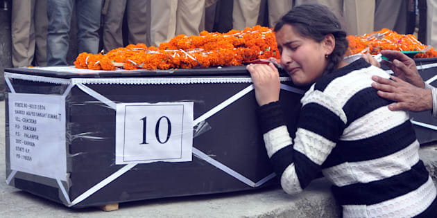 Daughter of martyr Sanjay Kumar, who was killed in Maoist attack in Sukma, Chhattisgarh, wails near his body during his funeral at his native village (Chechain) Nagri on April 25, 2017 near Dharamsala, India. (Photo by Shyam Sharma/Hindustan Times via Getty Images)