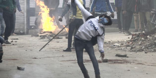 A file photo of demonstrators pelting stones during clashes in Jammu and Kashmir.