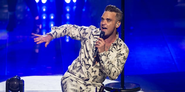 LONDON, ENGLAND - SEPTEMBER 25:  AVAILABLE FOR LICENSE FOR 30 DAYS FROM CREATE DATE.  Robbie Williams performs on stage at the Apple Music Festival at The Roundhouse on September 25, 2016 in London, England.  (Photo by Dave J Hogan/Dave J Hogan/Getty Images)
