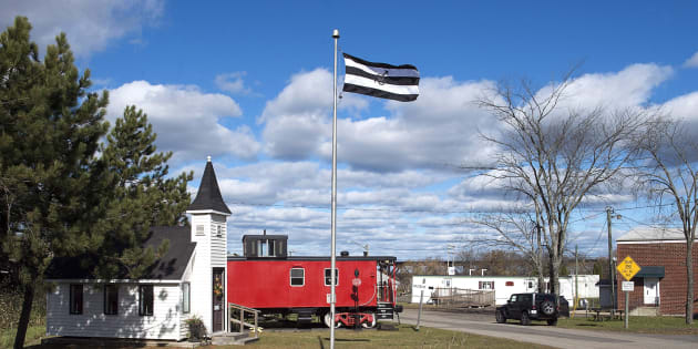 """A flag celebrating so-called """"straight pride"""" that was approved by the village council, flies in Chipman, N.B. on Oct. 22, 2018."""
