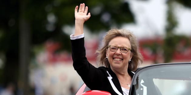 Green Party Leader Elizabeth May waves to the crowd as she rides in a sports car during the annual Victoria Day Parade in Victoria, B.C., on May 21, 2018.
