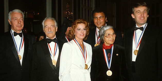 (Left to Right) Joe DiMaggio, Victor Borge, Anita Bryant, Muhammad Ali, Rosa Parks, and Donald Trump pose for a photograph after receiving the Ellis Island Medal of Honor October 27, 1986 in New York City.