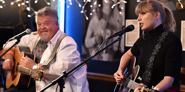 Craig Wiseman and special guest Taylor Swift perform onstage at Bluebird Cafe on March 31, 2018 in Nashville, Tennessee.