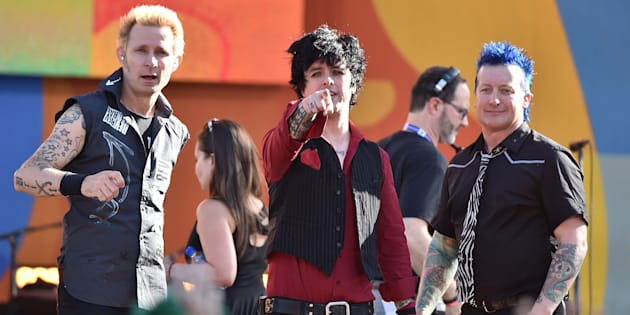 Green Day's Billie Joe Armstrong (centre) has defended the band after they were criticised for performing a festival set after an accident resulted in the death of a performer.