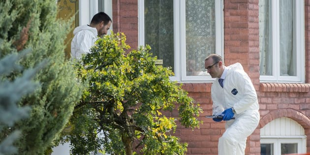 Police forensic investigators enter a home in Saint-Eustache, Que. on Sept.15, 2017. Quebec provincial police confirm a woman found dead in suburban Montreal is the mother of a six-year-old boy who is the subject of an Amber Alert.