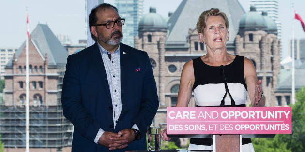 Ontario Liberal leader Kathleen Wynne speaks to the media while making a campaign stop in Toronto on May 28, 2018.