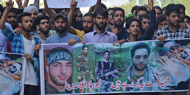 People raise slogans during a protest inside the Kashmir University campus on the second death anniversary of Burhan Wani.