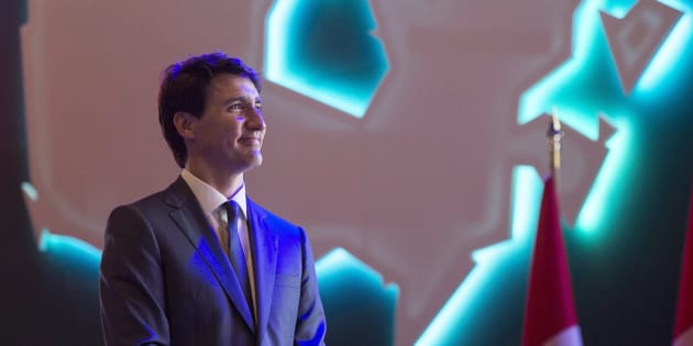 Prime Minister Justin Trudeau watches a video as he delivers a keynote address at the Federation of Canadian Municipalities' 2018 Annual Conference in Halifax on June 1, 2018.