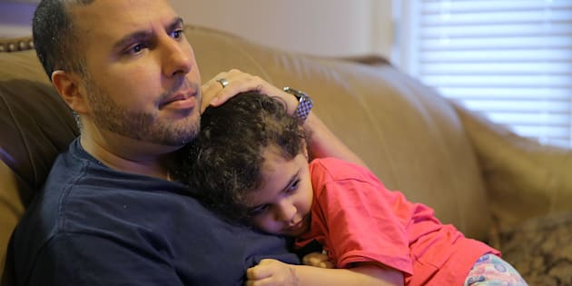 North Carolina resident Shadi Sadi holds his 5-year-old daughter Saja while watching the news at home on the morning after the election.
