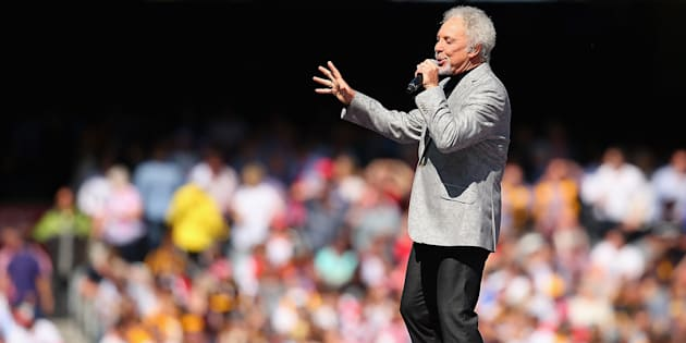 """She stood there laughing; I felt the knife in my hand and she laughed no more"": Tom Jones performs during the 2014 AFL Grand Final at the MCG."