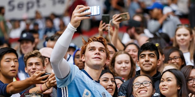 KJ Apa takes a selfie with fans after the Legends And Stars: Whitecaps FC Charity Alumni match at BC Place on September 16, 2017 in Vancouver.  (Andrew Chin/Getty Images)