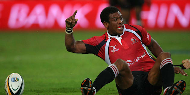 Ashwin Willemse celebrates after scoring his try during the round-two Super 14 match between the Sharks and the Lions at ABSA Stadium on February 21 2009, in Durban.