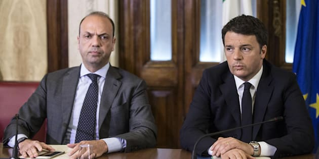 Matteo Renzi, right, while presiding the meeting of the national pubblic safety committee summoned by Angelino Alfano, left, after the terror attacks today in Brussels. Rome, March 22, 2016. ANSA/ ANGELO CARCONI