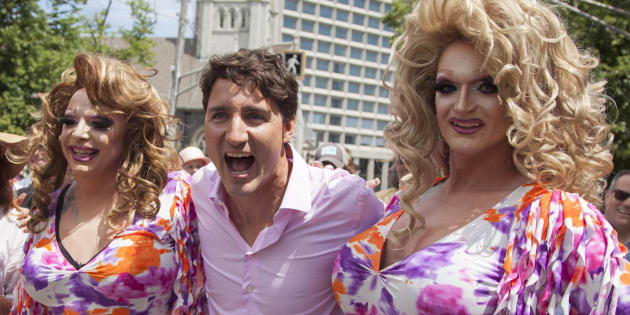 Prime Minister Justin Trudeau, poses for a photo with parade-goers during the annual Halifax Pride Parade on Saturday.