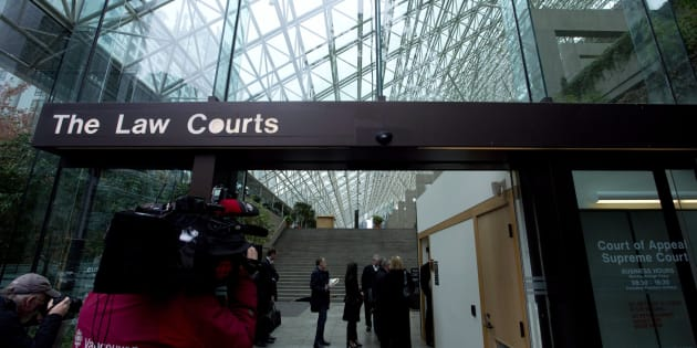 People line up to be screened to enter the B.C. Supreme Court in Vancouve on Sept. 30, 2013, the day the trial of the Surrey mass murder that left six dead opened.