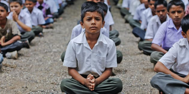 Students pray during a morning assembly at a school in the Ralegan Siddhi village, located in the Ahmednagar district about 250km (155 miles) south east of Mumbai June 17, 2011.