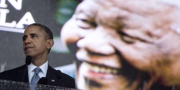 Then US President Barack Obama speaking during the memorial service for late South African President Nelson Mandela at Soccer City Stadium in Johannesburg on December 10, 2013.