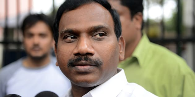 Former telecom minister A. Raja gesture as he interacts with the media following his appearance in connection with the 2G spectrum scam at the CBI court in New Delhi on May 5, 2014.