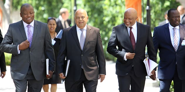 The minister and his men... Minister of Finance Pravin Gordhan (centre) has ordered an inquiry into Sars.