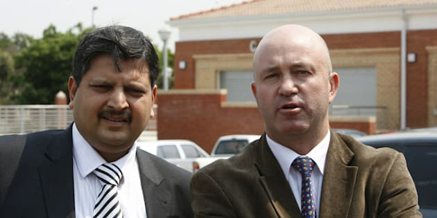 One of the Gupta brothers, Atul Gupta with his lawyer Cliff Alexander outside the Randburg Magistrate's court on September 27, 2010.
