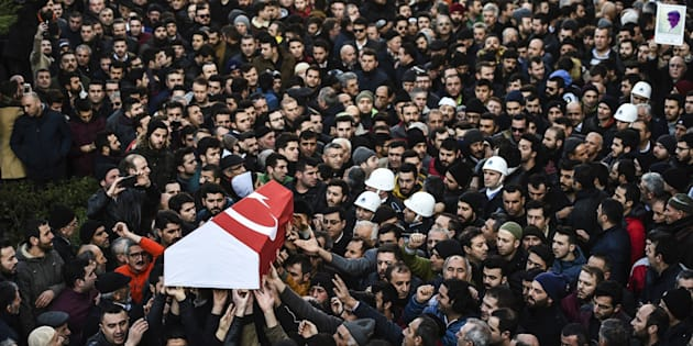 People carry the coffin of Yunus Gormek, 23, one of the victims of the Reina night club attack, during his funeral ceremony on Jan. 2, 2017, in Istanbul.