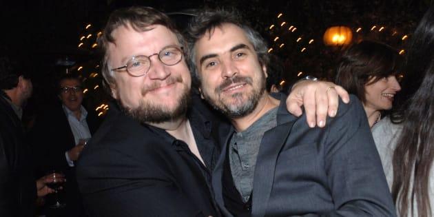Guillermo del Toro y Alfonso Cuarón durante una cena en Pane e Vino en Los Ángeles.