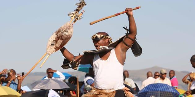 President Zuma's eldest son Edward dances past the groomsmen at his wedding to Phumelele Shange on October 8, 2011 in Nkandla, South Africa.